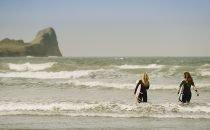 Surfers at Llangennith Beach © Visit Swansea Bay / Swansea Council